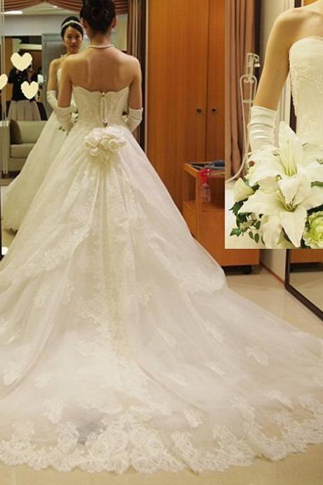 Lace Appliqués Tulle Strapless Floor Length Wedding Gown Featuring Train
